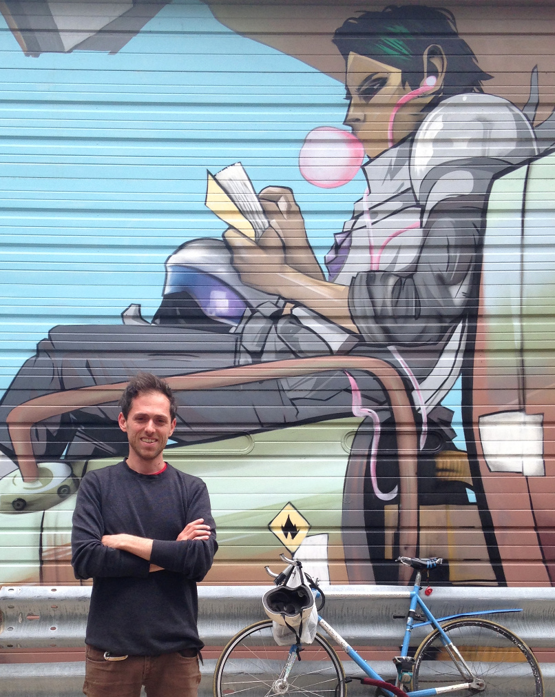 Image of Marc in front of Saga mural in Chicago